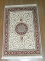 Hand knotted silk carpet Persian design