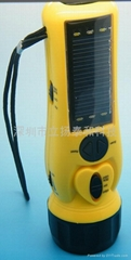Solar charger with flashlight and radio
