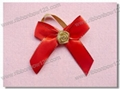 red bow with gold border and flower