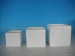 white ceramic flower pots