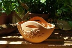 Terracotta pot with flower basket design
