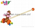 wooden push along toy with monkey