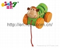 wooden pull along toy with monkey