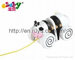 wooden pull along toy with cow