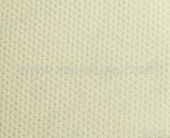 Nonwoven fabric with sesame design