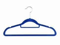 Suit hanger with tie bar and indent