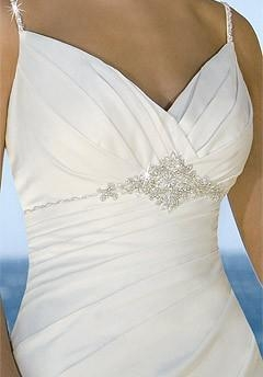 Beach wedding gown features in satin and drapes in a modified silhouette 2