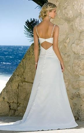 Beach wedding gown features in satin and drapes in a modified silhouette 3