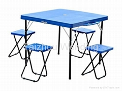 blue plastic camping table with 4 stools
