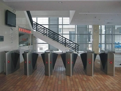 Retractable flap barrier turnstile