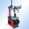 Semi automatic tire fitting machine with