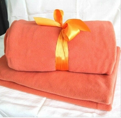 Solid colour coral plush throw/blanket