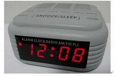 grey alarm clock with radio