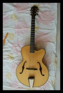 Wholesale fullyhandmade jazz guitar with solid wood. 1