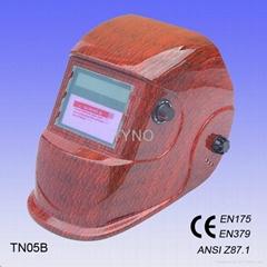 Auto darkening welding mask