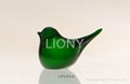 green hand made glass bird