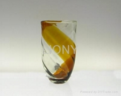 clear hand made blown glass vase with amber stripe
