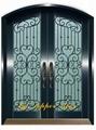 copper door with wrought iron flower