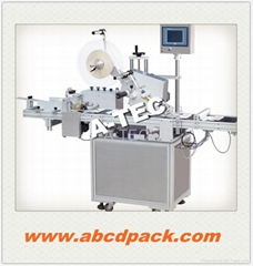 Electric top automatic box labeller