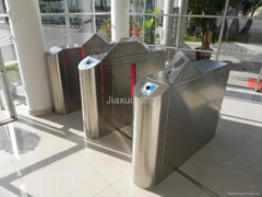 Wing barrier turnstile gate
