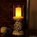 Polyresin angel candle holder with pillar candle