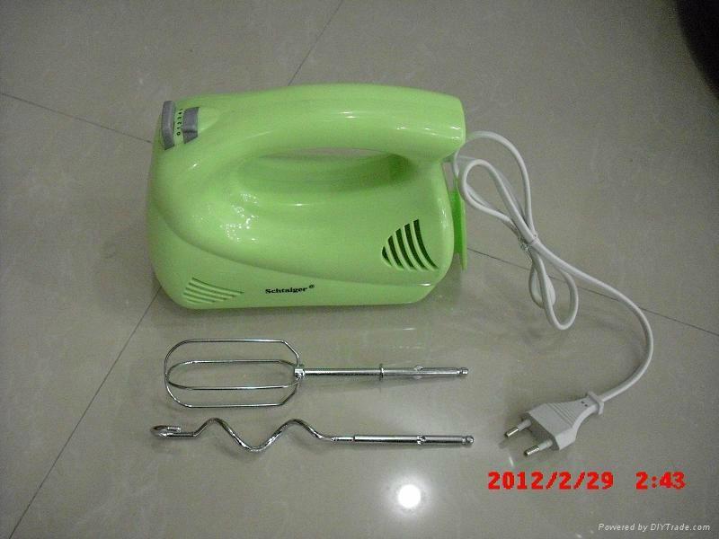 green plastic egg beater 1