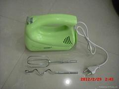 green plastic egg beater