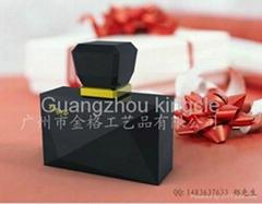 Black glass perfume bottle