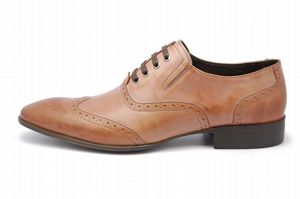 Oxford Italian Leather Dress Shoes for Men The understated medallion detail at the toe signals stately sophistication, the mark of a man with discriminating tastes. Flawless with khakis, jeans, and wool trousers, these dress shoes are sure to put your best foot forward.