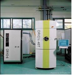 Vacuum evaporation system for optics