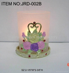 Metal candle holder with colorful epoxy flowers
