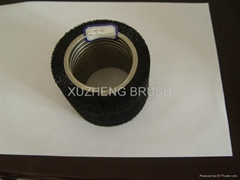 Coiled cylinder brush with short stiff