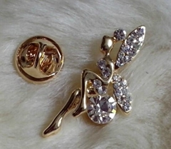 angel and peacock brooch with crystal stones