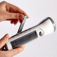 Solar dynamo torch radio charger
