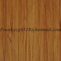Colorful face on wooden board