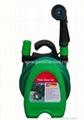 Portable garden hose hanger with hose