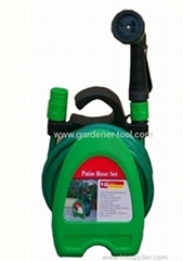 Portable garden hose hanger with hose and nozzle