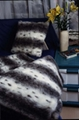Silver fox throw and matching cushion