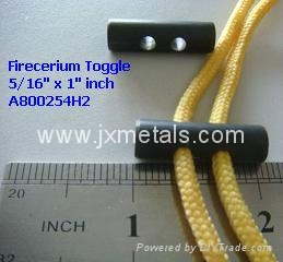 Ferrocerium toggle button or toggle fire starter
