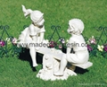 resin garden/boy and girl seated on a bench
