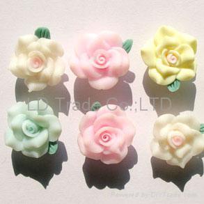 http://img.diytrade.com/cdimg/455477/2597138/0/1205306593/FIMO_Flowers_FIMO_beads_Mobile_decoration.jpg