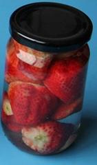 strawberry in glass jar