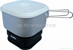 Dual-voltage travel cooker