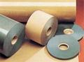 Insulating paper/polyester film laminate
