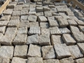 Yellow cobblestone paving stone