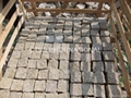 Cobblestone paving stone in color of black gray yellow grey red granite