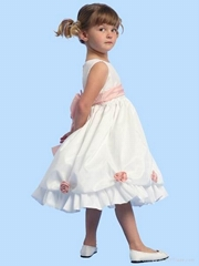 White taffeta flower girl dress with pink handmade flowers and ribbon