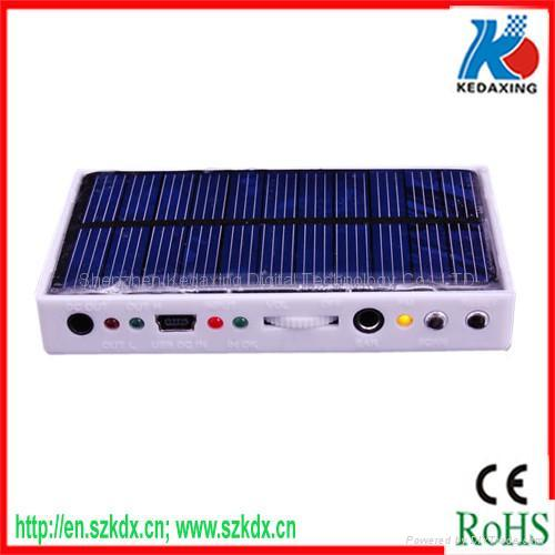 Solar mobile phone charger with radio and UV money-detector function 1