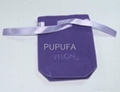 Purple velvet pouch with embossed logo