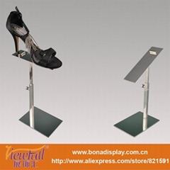 Polished metal shoes display